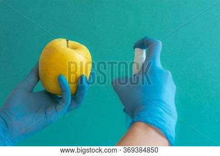 Blue Latex Medical Gloves On A Woman's Hand, Antiseptic Treatment. Women's Gloved Hands Holding An A