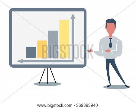 Confident Young Man Standing Near Flip Chart And Pointing Graph And Diagram. Creative Business Conce
