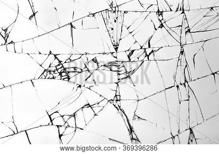 Texture Of Broken Glass, Cracks On Glass With White Background, Concept Of Cracks For Design.