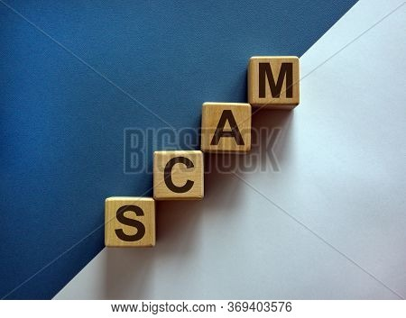 Wood Cubes With Word 'scam' Stacking As Step Stair On Paper Blue And White Background, Copy Space. C