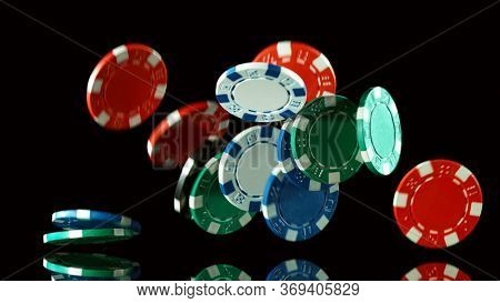 Poker still life with falling poker chips . Concept of hazard gaming. Isolated on black background
