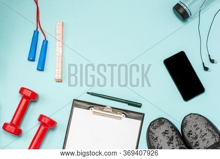 Flat Lay Of Sports Equipment For Fitness On A Blue Background. The Concept Of A Healthy Lifestyle, S