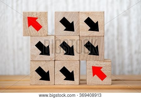 Wooden Block With Red Arrow Facing The Opposite Direction Black Arrows, Individuality And Standing S