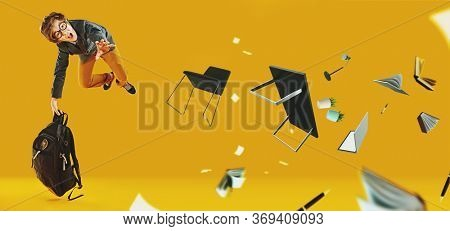 Educational concept. Unhappy schoolboy in glasses flies through the air and screams in displeasure and surprise. Yellow background. Copy space.