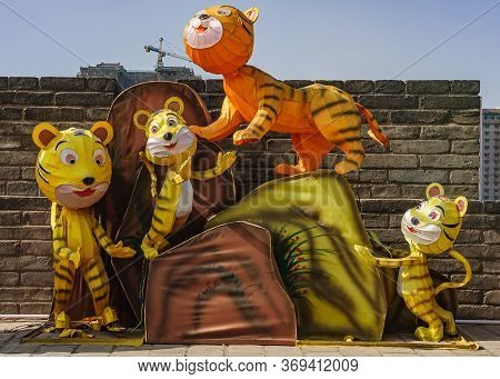 Xian, China - April 30, 2010: North Gate Of Huancheng City Wall Rampart. Year Of The Tiger Display.