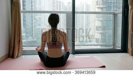 Woman do yoga at home