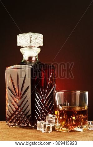 An Elegant Antique Look And Feel To This Focused Theme Of Whisky On The Rocks.