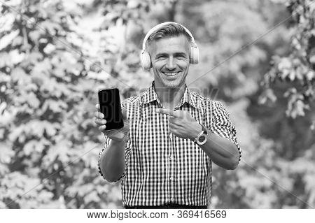 Musical Service. Handsome Well Groomed Man Listening Podcast. Online Blog. Digital Influencer. Onlin