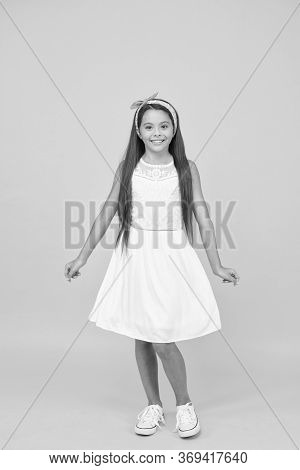 Cute Girly Girl. Happy Girl Yellow Background. Fashion Look Of Small Girl. Little Girl Wear Long Bru