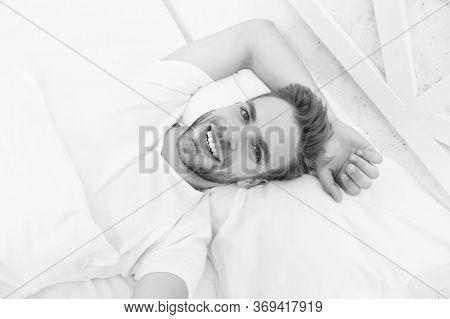 Handsome Man Relaxing In Bed. Establish Regular Nightly Sleep Pattern. Practice Calming Activities S