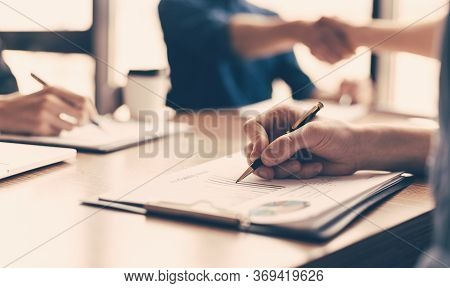Close Up. Business Colleagues Work With Financial Documents.