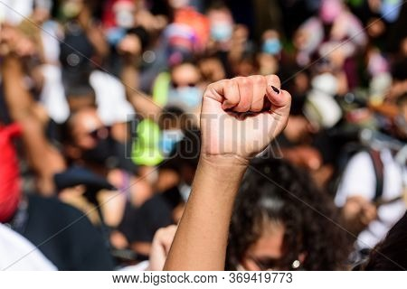 White Hand On A Black Rights Demonstration. White And Black People Together. Anti Racism In The Usa.