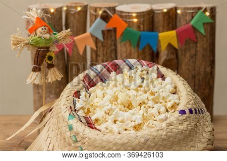 Popcorn Served In A Straw Hat With Party June Decoration In The Background. Festa Junina: Typical Br