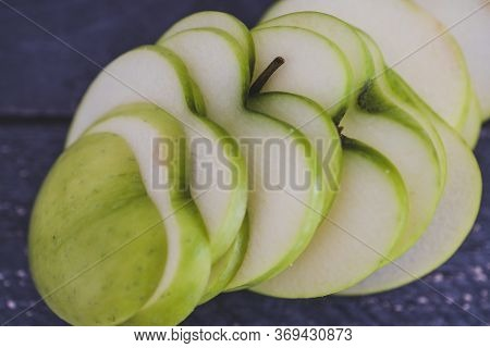 Food Ingredients Concept, Green Apple Cut Into Thin Equal Slices With A Heart Shape