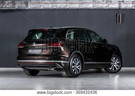 Novosibirsk/ Russia - March 15, 2020: Black  Volkswagen Touareg, Back View.  New Expensive Crossover