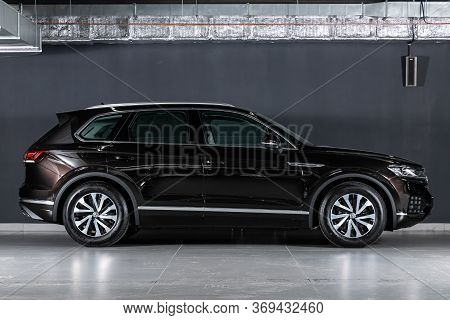 Novosibirsk/ Russia - March 15, 2020: Black  Volkswagen Touareg, Side View.  New Expensive Crossover