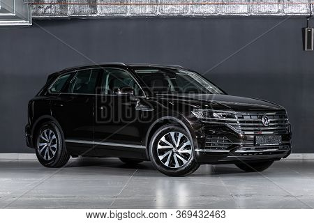 Novosibirsk/ Russia - March 15, 2020: Black  Volkswagen Touareg, Front View.  New Expensive Crossove