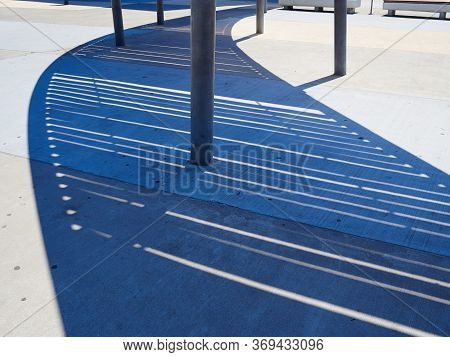 Modern Futuristic Design Metal Pergola Arbor Cast Shadow On The Ground Creating Interesting Pattern