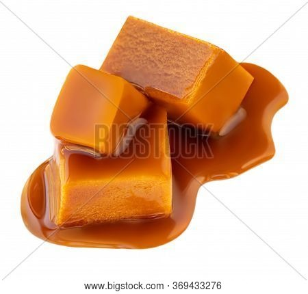 Caramel Isolated On White Background. Caramel Pieces With Flowing Toffee Sauce, View From Above