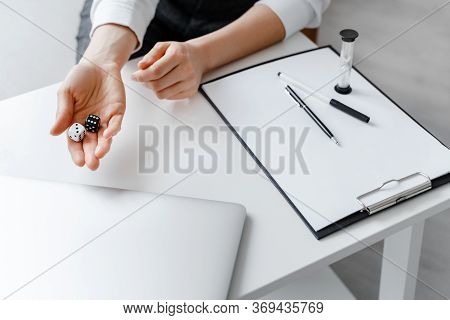 Black And White Dices In Woman Hand. Psychologist Concept, Business, Analytics Of Business, Marketin