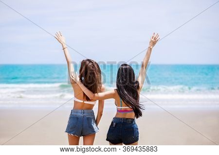 Outdoor Summer Portrait Of The Back Image Of Two Asian Beautiful Girls In A Sexy Bikini Standing On