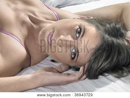 Lingerie Dressed Lady Resting On Bed