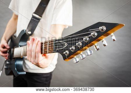 Close Up On Guitar Fretboard