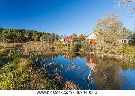 Porvoo, Finland, October 08, 2016: Water Canal And Colored Houses In Old Town Porvoo.