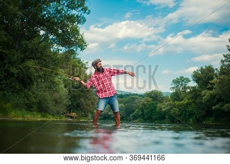 Big Game Fishing. Hobby Of Businessman. Fly Fish Hobby Of Man In Checkered Shirt. Young Man Fishing.