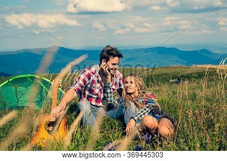 Couple Camping. Romantic Couple In Love Traveling And Camping. Young Couple Of Tourists Are Explorin