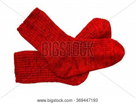 Red Pair Of Woolen Socks Isolated On White Background. Clipping Path Included.