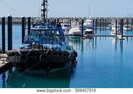 Mackay, Queensland, Australia - June 2020:  A Tugboat Moored At The Marina