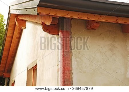 The Exterior Of A Newly Built Wooden (fir) House. The Exterior Insulation Comprises Expanded Polysty