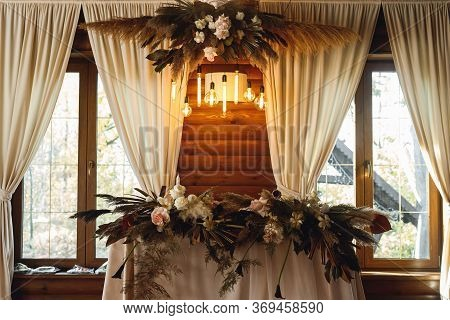 The Presidium Of The Newlyweds With Fresh Flowers At The Wedding In Restaurant. Banquet Table For Ne