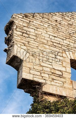 Close-up Of Old Ruin Of An Austrian Fortified Wall Made Of Stone Blocks On Blue Sky With Clouds. Ver