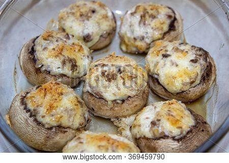 Stuffed Mushrooms Stuffed With Cheese, Mushroom Stalks And Onions. In A Baking Dish.