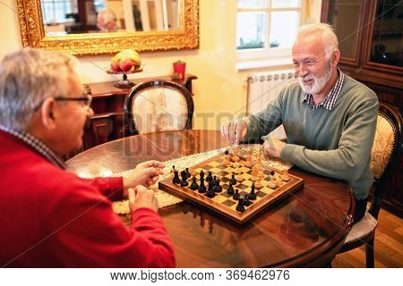 Preparing To Make A Move In A Game Of Chess