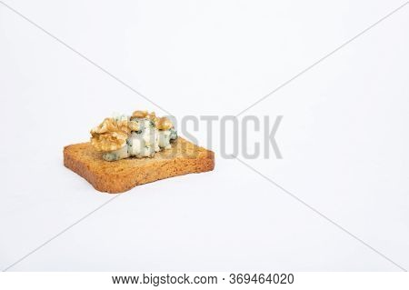 Snack Of Toasted Bread With Blue Cheese And Walnut. Healthy French Breakfast Antipasto. Cheese Snack