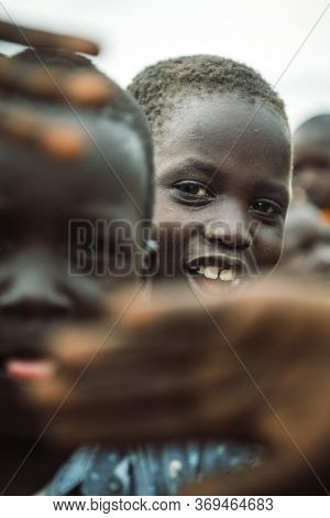Toposa Tribe, South Sudan - March 12, 2020: Children From Toposa Tribe Gesticulating And Looking At