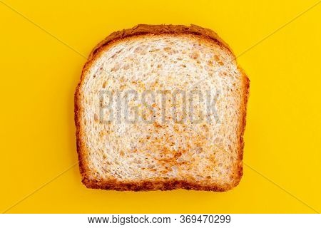 Close Up Photo Of Toasted Bread On Yellow Background. Top View Of Roasted Toast. Fried Bread For Bre