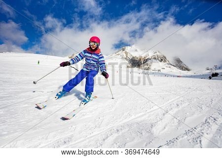 Portrait In Motion Of A Girl Doing Alpine Ski Excurse Mowing Downhill