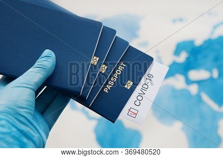 Immunity Passport, Risk-free Certificate Concept. Hand In Medical Gloves Holds Passports With Note C