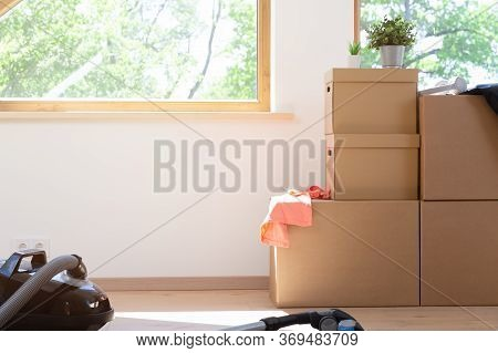 Move. Cardboard Boxes For Moving Into A New, Clean Home. In A Sunny Day By A Window In Attic.