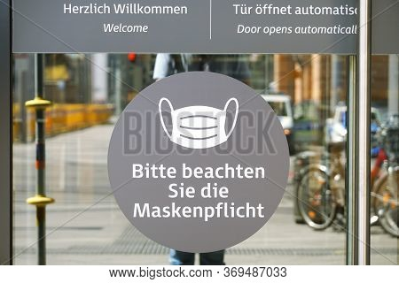 Hannover, Germany - May 21, 2020: German Language Sign On Entrance Door To Shopping Center Advises T