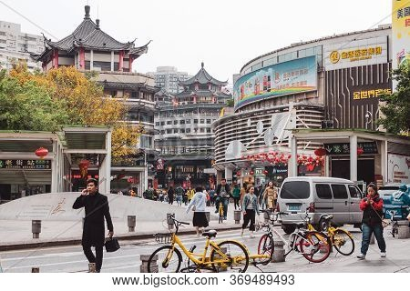 Crowded City Street In A Chinese City. People On A City Street In A Hurry About Their Business. Shen