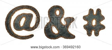 Set of symbols at, ampersand and hash made of leather. 3D render font with skin texture isolated on white background. 3d rendering