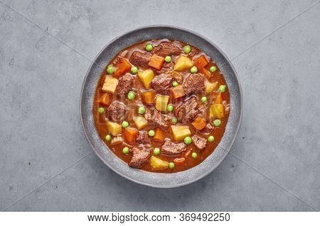 Irish Beef Stew In Matt Gray Bowl On Concrete Background. Stew With Beef Or Lamb Meat With Potatoes,