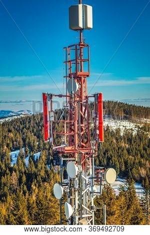 Telecommunication Tower With Antennas In Mountain Landscape.