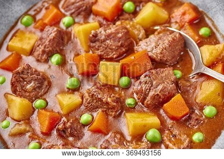 Irish Beef Stew Close Up. Stew With Beef Or Lamb Meat With Potatoes, Carrots, Peas And Herbs.