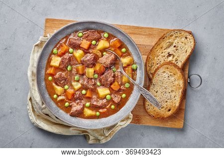 Irish Beef Stew With Bread In Matt Gray Bowl On Concrete Background. Stew With Beef Or Lamb Meat Wit